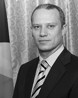 Minister Jean-Paul Adam
