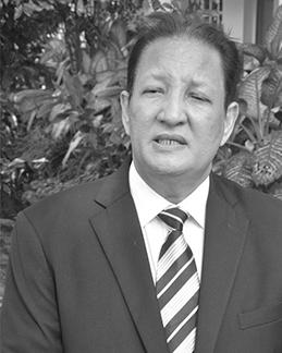 Minister Peter Larose